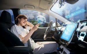 woman using smart phone in autonomous car.